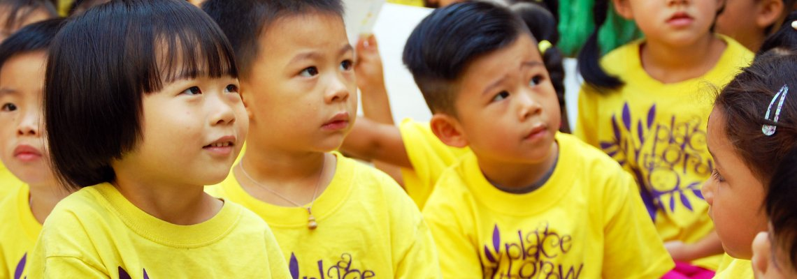 Children from the Little Star Stepping Up wearing yellow