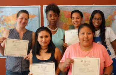 Women holding certifications awards