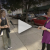 Levka is interviewed by a CBS reporter on the street using a long mic