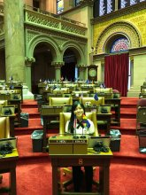 CPC participant sits in Assemblywoman Niou's Assembly Chamber chair