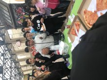 Participants enjoy refreshments and pizza at the event