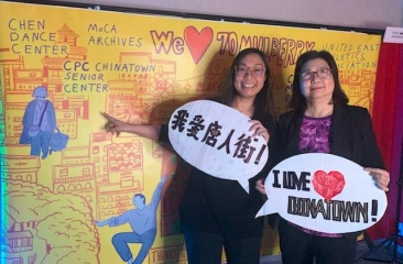 Kim To (left), Chief Development Officer, and Christina Wong (right), Assistant Director of CPC Chinatown Senior Center, pose in front of mural created for Chinatown Fire Relief Fundraiser