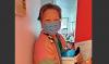 Hong Ning Resident holds their box of masks.